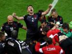 pemain-albania-merayakan-gol-ke-gawang-rumani_20160620_035324.jpg
