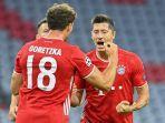 pemain-depan-bayern-munich-robert-lewandowski-kanan-merayakan-gol.jpg