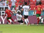 pemain-depan-portugal-cristiano-ronaldo-kiri-bereaksi-terhadap-gol-pertama-timnya.jpg