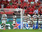 pemain-depan-portugal-cristiano-ronaldo-kiri-dan-rekan-satu-timnya-merayakan-gol-pertama-mereka.jpg