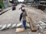 pemasangan-tol-air-di-jalan-pagarsih-sudah-selesai_20180114_215821.jpg