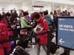 Maskapai Penerbangan AS Melobi Gedung Putih Berlakukan Paspor Virus Seperti di China