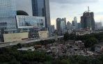 pemukiman-warga-terdesak-pembangunan-gedung-komersil_20141221_201652.jpg