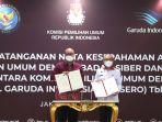 penandatanganan-mou-kpu-dengan-bssn-dan-garuda-indonesia_20210602_204958.jpg