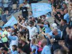 pendukung-manchester-city-mengibarkan-bendera-menjelang-pertandingan-final-liga-champions.jpg