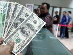 penukaran-mata-uang-dolar-as_20150304_145810.jpg