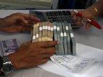 penukaran-uang-receh-di-bank-indonesia-pekanbaru_20160614_114314.jpg
