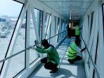 penyemprotan-antisipasi-pandemi-virus-corona-di-bandara-semarang_20200313_161150.jpg