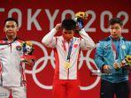 peraih-medali-emas-china-li-fabin-tengah-menyesuaikan-masker-wajahnya.jpg