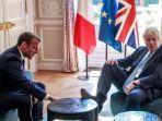 perdana-menteri-inggris-boris-johnson-dan-presiden-perancis-emmanuel-macronjpg.jpg