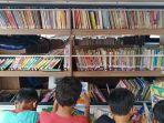 perpustakaan-keliling-kel-rawa-bunga-diminati-warga_20210928_204303.jpg