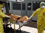 petugas-kesehatan-mengenakan-alat-pelindung-dalam-latihan-dalam-menangani-pasien-covid-19.jpg