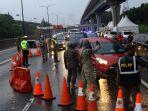 petugas-perketat-kendaraan-yang-hendak-masuk-jakarta_20200528_235205.jpg