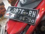 plat-motor-yamaha-mio-h3876rh-yang-terlibat-kecelakaan-di-jalan-perintis-kemerdekaan_20170922_083928.jpg