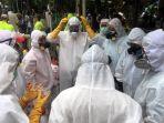 pmi-kerahkan-3000-relawan-untuk-penyemprotan-disinfektan_20200327_220716.jpg