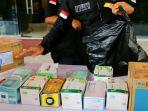 polisi-amankan-penimbun-masker-dan-hand-sanitizer-di-jateng_20200304_163926.jpg