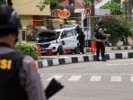 polisi-periksa-mobil-yang-dipakai-teroris-di-riau_20180516_194449.jpg