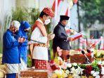 presiden-joko-widodo-mengenakan-pakaian-adat-lampung_20210817_210857.jpg