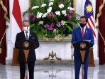 Jokowi Titip Pekerja Migran Indonesia kepada PM Malaysia