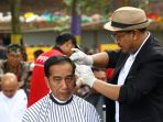 presiden-jokowi-ikut-potong-rambut-massal_20190120_004329.jpg