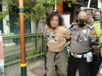 pria-yang-memukul-polisi-di-jalan-kyai-mojo-karena-ditegur-tak-pakai-masker.jpg