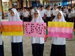 ratusan-siswa-dan-guru-smp-islam-diponegoro-solo-gelar-aksi-solidaritas_20180205_194742.jpg