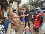 relawan-abj-membagikan-bantuan-kepada-warga-terdampak-pandemi-covid-19.jpg