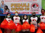 relawan-kib-bagikan-makanan-dan-masker.jpg