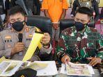 Satgas Nemangkawi Tangkap 4 KKB Anggota Joni Botak di Jalan Trans Papua