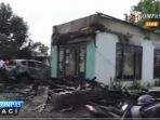 rumah-dan-mobil-aktivis-antikorupsi-dibakar_20170207_141439.jpg