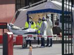 rumah-sakit-di-prancis-mendirikan-tenda-untuk-korban-covid-19_20200327_180409.jpg