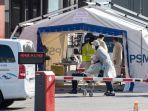 rumah-sakit-di-prancis-mendirikan-tenda-untuk-korban-covid-19_20200327_180417.jpg