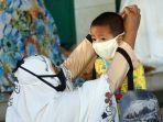 salat-idul-fitri-di-tengah-pandemi-covid-19-di-masjid-al-istiqom_20200524_182230.jpg