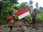 sambut-hut-ri-ke-76-anak-anak-papua-bersukaria-kibarkan-bendera_20210816_074150.jpg