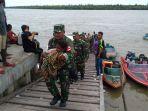 satgas-kesehatan-tni-evakuasi-pasien-ke-rsud-agats-papua_20180123_103416.jpg