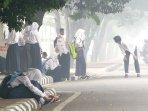 sejumlah-pelajar-di-pontianak-diliburkan-karena-kabut-asap_20151002_173332.jpg