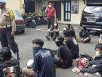 sejumlah-peserta-demo-hari-tani-di-kota-solo-ditangkap-anggota-polresta-solo-kamis-2492020.jpg