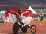 selebrasi-atlet-para-atletik-indonesia-jaenal-aripin_20181012_165614.jpg