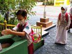 siswa-dan-guru-mengikuti-simulasi-pembelajaran-tatap-muka-ptm-di-sd-negeri-cimahi-mandiri-2.jpg