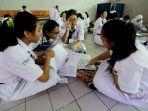 siswa-smpn-1-jakarta-ikuti-unbk_20190422_121129.jpg