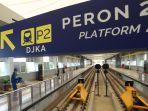 stasiun-lrt-bandara-palembang-disemprot-disinfektan_20200318_212540.jpg