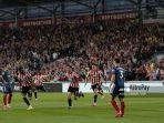 striker-brentford-spanyol-sergi-canos-tengah-merayakan-mencetak-gol.jpg