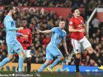 striker-burnley-chris-wood-merayakan-gol-yang-dicetak-ke-gawang-manchester-united.jpg