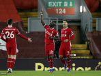 striker-liverpool-senegal-sadio-mane-tengah-merayakan-mencetak-gol-pertama-timnya.jpg