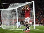 striker-manchester-united-prancis-anthony-martial-bereaksi-setelah-gagal-mencetak-gol.jpg