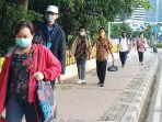 tertib-mengenakan-masker-penumpang-jasa-krl_20200519_185540.jpg