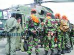 tim-evakuasi-korban-helikopter-jatuh_20161130_095534.jpg