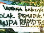 Pemudik Disambut Spanduk Penolakan, Tanpa Tes Covid-19 Dilarang Masuk Wilayah Kartini Jakarta Pusat
