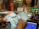 transaksi-ringgit-malaysia-di-pedagang-valas_20160504_104817.jpg