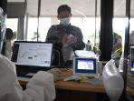 uji-coba-genose-c19-di-bandara-juanda_20210326_051113.jpg